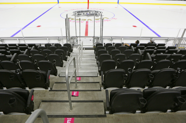 Rich Belsky, left, and Joe Hulbert sit near center ice during an open house for prospective 2017 Vegas NHL hockey season ticket holders at T-Mobile Arena Monday, Aug. 1, 2016, in Las Vegas. (Ronda ...