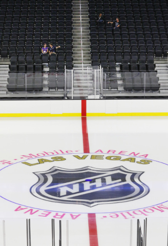 People sit near center ice during an open house for prospective 2017 Vegas NHL hockey season ticket holders at T-Mobile Arena Monday, Aug. 1, 2016, in Las Vegas. (Ronda Churchill/Las Vegas Review- ...