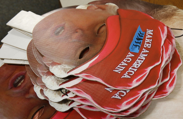 Cutouts shaped Republican presidential candidate Donald Trump's face sit on the table at an office of For Nevada's Future in North Las Vegas, Wednesday, Aug. 31, 2016, as people from Nevada progre ...