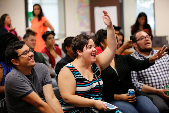 Eric Sutton, from left, Annette Magnus, Mackenzie Matheny and Leo Murrieta, all from Las Vegas, react at an office of For Nevada's Future in North Las Vegas, Wednesday, Aug. 31, 2016, as they watc ...