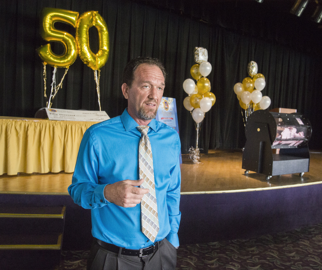 Riverside Resort slot manager Don Nelson prepares for the $50,000 drawing during the 50th anniversary party for the resort in Laughlin on Tuesday, Aug. 2, 2016. (Jeff Scheid/Las Vegas Review-Journ ...