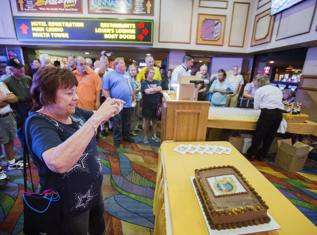 Diana Tompkins, from Gilbert, Ariz, takes a photo of the  Riverside Resort 50th anniversary cake in Laughlin on Tuesday, Aug. 2, 2016. (Jeff Scheid/Las Vegas Review-Journal) Follow @jeffscheid