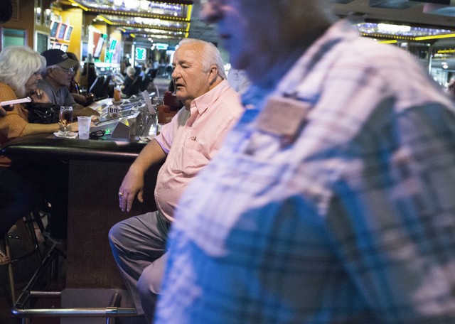 High roller gambler Cliff Dent , from Ariz., takes a break while playing four-card keno at the Riverside Resort, during the 50th anniversary party for the resort in Laughlin on Tuesday, Aug. 2, 20 ...