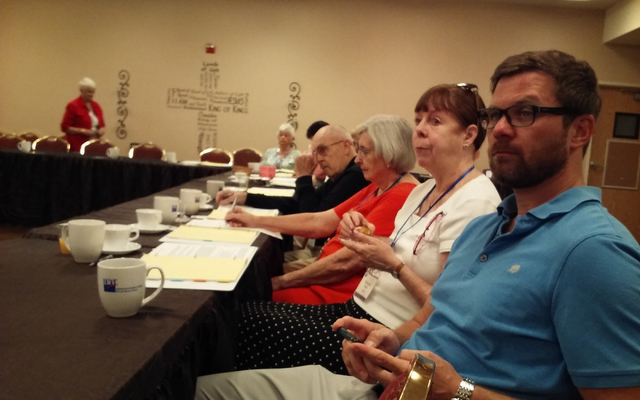 Political consultant Scot Rutledge, forefront, sits with, from right, Kathleen Dickinson, law-related education coordinator at the State Bar of Nevada; Frances Rust, acting treasurer and secretary ...
