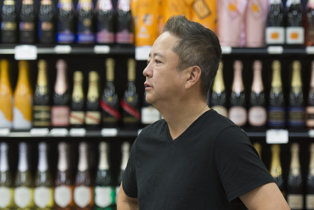 Kenny Lee, president of Lee's Discount Liquor, watches shoppers during the grand opening of the store at 1450 W. Horizon Ridge Parkway in Henderson on Saturday, Aug. 6, 2016. (Jason Ogulnik/Las Ve ...