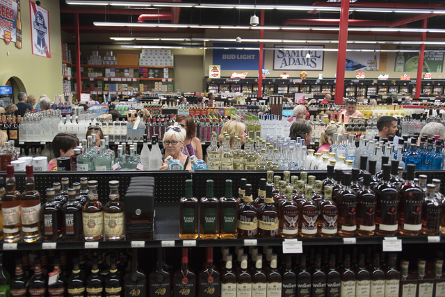 Shoppers browse the aisles as they wait in line for an autograph from Diane Keaton during the grand opening of Lee's Discount Liquor at 1450 W. Horizon Ridge Parkway in Henderson on Saturday, Aug. ...