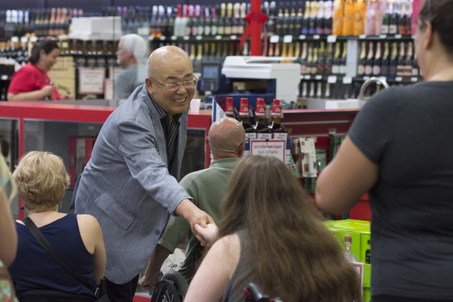 Hae Un Lee, founder of Lee's Discount Liquor, greets shoppers during the grand opening of the store at 1450 W. Horizon Ridge Parkway in Henderson on Saturday, Aug. 6, 2016. (Jason Ogulnik/Las Vega ...