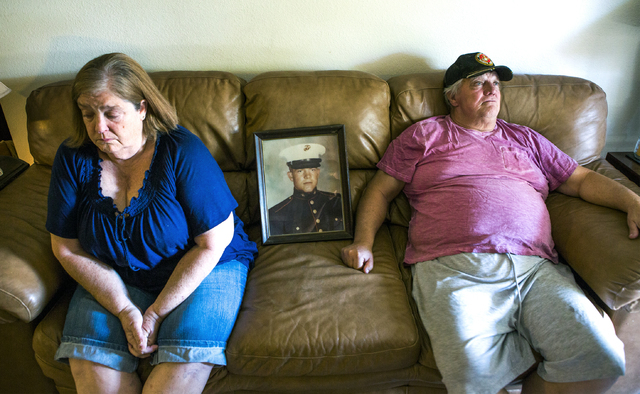 Linda Furrow, left, and her husband Marine veteran Stanley Furrow, sit in the family's home in Las Vegas, Thursday, Aug. 11, 2016. The photo is of Stanley Furrow while he was stationed at Marine C ...