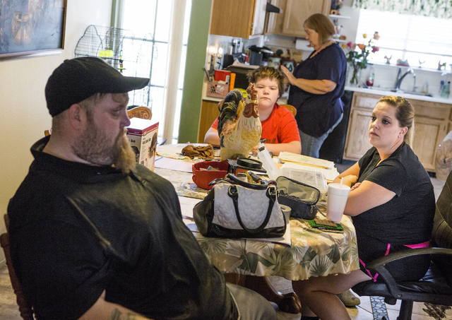 Stanley Furrow Jr., 33, left, sits in the family's dining room with nephew Joseph, 13, mother, Linda, and sister, Jolie, 32, on Thursday, Aug. 11, 2016.The family claims their health issues are ca ...