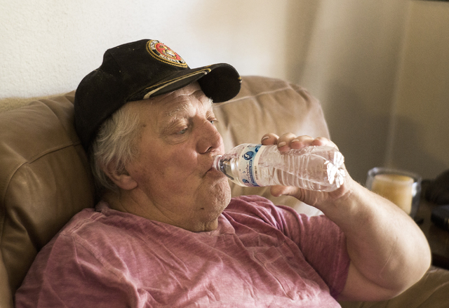 Marine veteran Stanley Furrow drinks a bottle of water in the family's home in Las Vegas on Thursday, Aug. 11, 2016. The family claims their health issues are cause by water laced with solvents at ...