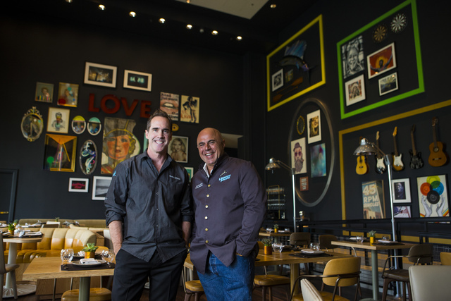 Chef Shawn McClain, left, poses with mixologist Tony Abou-Ganim at Libertine Social. Behind them are the belongings of a fictional guy named Kyle. Chase Stevens/Las Vegas Review-Journal Follow @cs ...