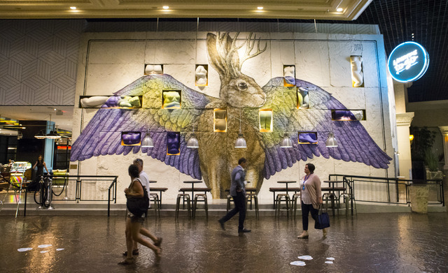 People walk by Libertine Social in the Mandalay Bay hotel-casino in Las Vegas on Thursday, Aug. 18, 2016. Chase Stevens/Las Vegas Review-Journal Follow @csstevensphoto