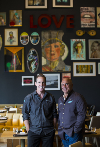 Chef Shawn McClain, left, poses with mixologist Tony Abou-Ganim at Libertine Social in the Mandalay Bay hotel-casino in Las Vegas on Thursday, Aug. 18, 2016. Chase Stevens/Las Vegas Review-Journal ...