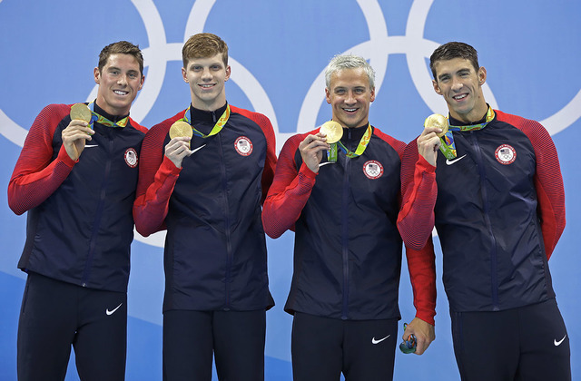(From left, Conor Dwyer, Townley Haas, Ryan Lochte and Michael Phelps from the United States show off their medals during the ceremony for the men's 4x200-meter freestyle relay final during the sw ...