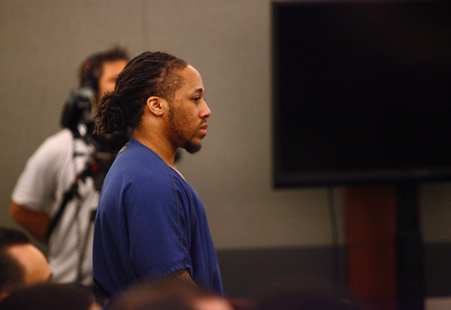 "Michael Solid, charged in the slaying of 15-year-old Marcos Vicente Arenas, listens as attorneys argue over whether to allow filming by MY Entertainment's ""Las Vegas Law"" television show dur ..."