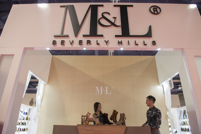Designer Mackin Jiang of M&L Beverly Hills, right, speaks to sales representative Teresa Yu at the MAGIC trade show inside the Las Vegas Convention Center on Monday, Aug. 15, 2016. Martin S. F ...