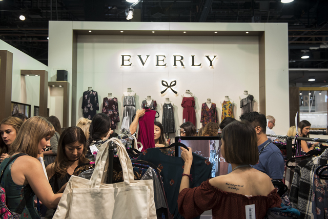 Attendees look through Everly women's clothing during the MAGIC trade show inside the Las Vegas Convention Center on Monday, Aug. 15, 2016. Martin S. Fuentes/Las Vegas Review-Journal