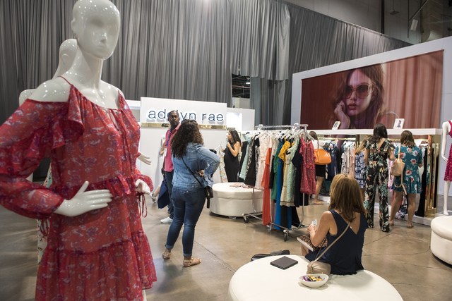 Attendees look through Adelyn Rae's clothing during the MAGIC trade show inside the Las Vegas Convention Center on Monday, Aug.15, 2016. Martin S. Fuentes/Las Vegas Review-Journal