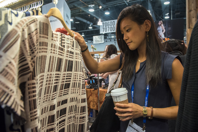 So Kim looks through the Freeway's clothing during the MAGIC trade show inside the Las Vegas Convention Center on Monday, Aug.15, 2016. Martin S. Fuentes/Las Vegas Review-Journal