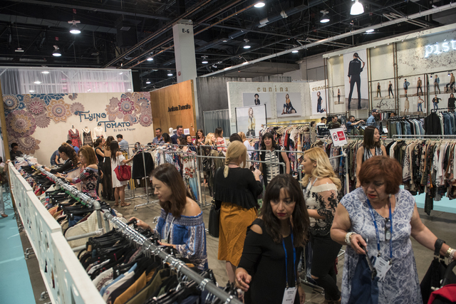 Attendees look through clothing at the Flying Tomato booth during the MAGIC trade show inside the Las Vegas Convention Center on Monday, Aug. 15, 2016. Martin S. Fuentes/Las Vegas Review-Journal