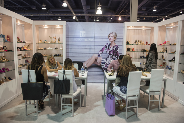 Attendees look at shoes in the Ivanka Trump's booth during the MAGIC trade show inside the Las Vegas Convention Center on Monday, Aug.15, 2016. Martin S. Fuentes/Las Vegas Review-Journal