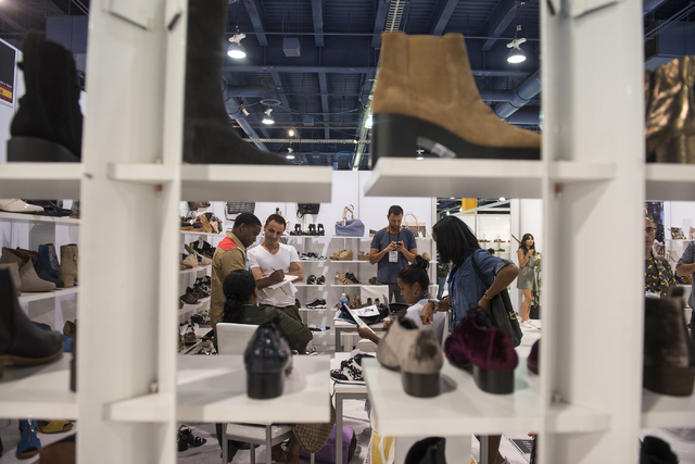 Attendees looks at shoes in the MTNG booth during the MAGIC trade show inside the Las Vegas Convention Center on Monday, Aug.15, 2016. Martin S. Fuentes/Las Vegas Review-Journal