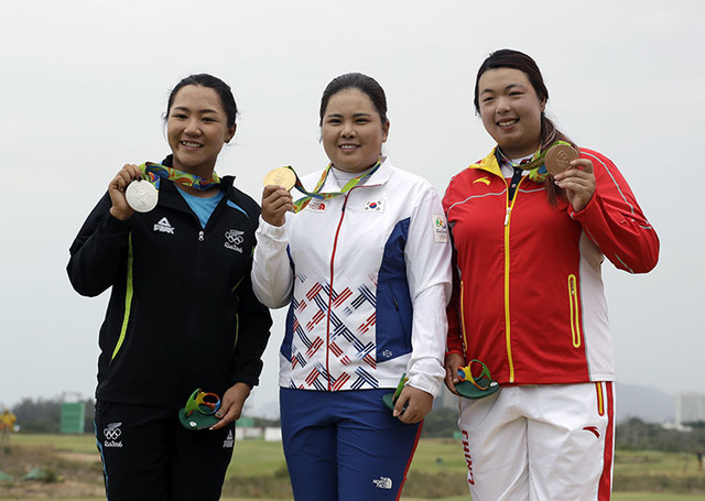 From left to right, silver medalist Lydia Ko of New Zealand, gold medalist Inbee Park of South Korea, and bronze medalist Shanshan Feng of China show their medals in Rio de Janeiro, Brazil, Saturd ...