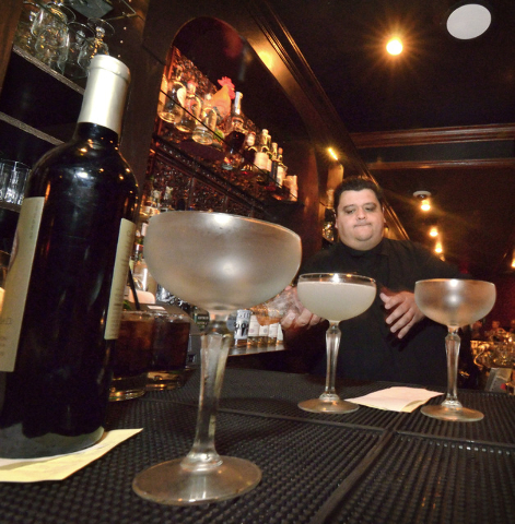 Nectaly Mendoza, owner of Herbs and Rye, mixes drinks in the bar and restaurant at 3713 Sahara Ave. in Las Vegas on Friday, Aug. 12,  2016. (Bill Hughes/Las Vegas Review-Journal)