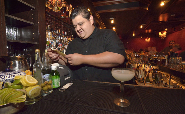 Nectaly Mendoza, owner of Herbs and Rye, checks an order ticket in the bar and restaurant at 3713 Sahara Ave. in Las Vegas on Friday, Aug. 12,  2016. (Bill Hughes/Las Vegas Review-Journal)