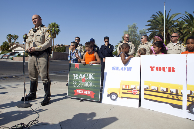 Sgt. Mike Lardomita talks about safe driving and preparing for heavier traffic around school areas during a press conference at the C.H. Decker Elementary School on Tuesday, Aug. 23, 2016, in Las  ...