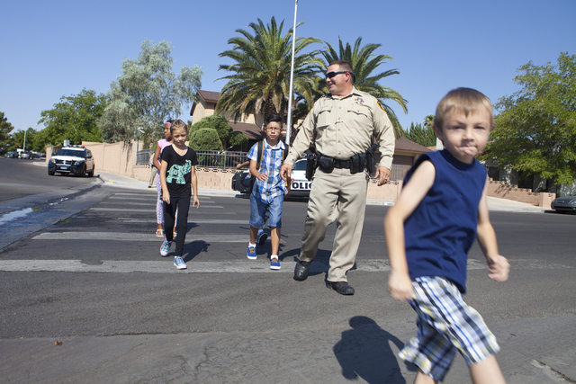 Las Vegas police officer Daryl McDonald demonstrates to students on how to safely cross the street at the C.H. Decker Elementary School on Tuesday, Aug. 23, 2016, in Las Vegas. (Loren Townsley/Las ...