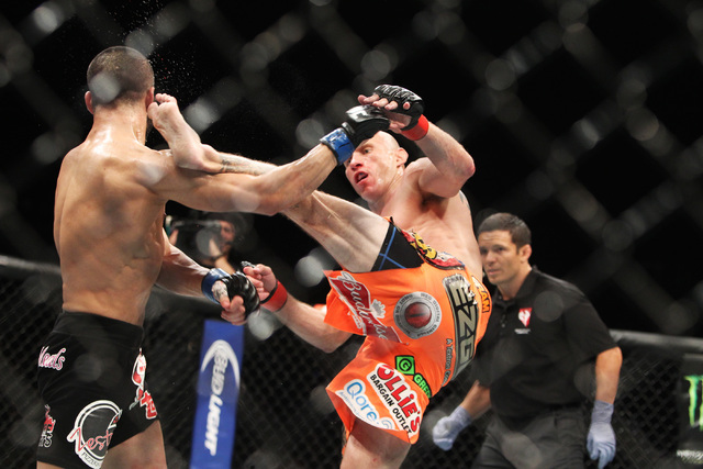 Donald Cerrone connects with a kick to the head of John Makdessi and breaks his jaw during their fight at UFC 187 Saturday, May 23, 2015, at the MGM Grand Garden Arena. Cerrone won by TKO in the s ...