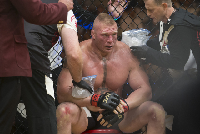 Brock Lesnar rests on his corner in between rounds in his fight against Mark Hunt in the heavyweight bout during UFC 200 at T-Mobile Arena on Saturday, July 9, 2016, in Las Vegas. Lesnar won by un ...