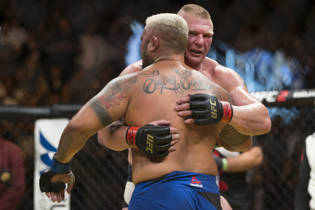 Mark Hunt hugs Brock Lesnar in the heavyweight bout during UFC 200 at T-Mobile Arena on Saturday, July 9, 2016, in Las Vegas. Lesnar won by unanimous decision. (Erik Verduzco/Las Vegas Review-Jour ...