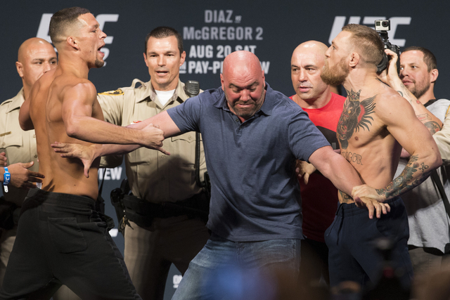 Nate Diaz, left, and Conor McGregor pose during UFC 202 weigh-in at the MGM Grand hotel-casino on Wednesday, Aug. 17, 2016, in Las Vegas. (Erik Verduzco/Las Vegas Review-Journal) Follow @Erik_Verduzco