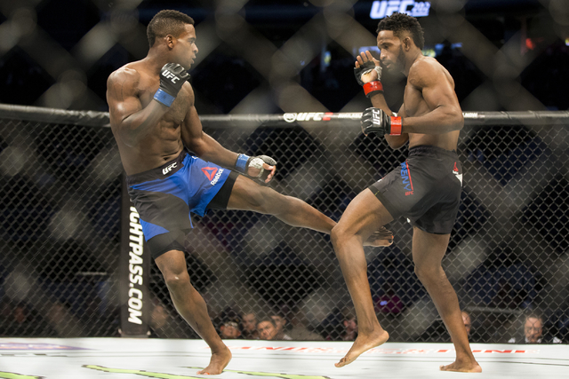 Lorenz Larkin, left, connects a kick against Neil Magny in the UFC 202 welterweight bout at T-Mobile Arena on Saturday, Aug. 20, 2016, in Las Vegas.  (Erik Verduzco/Las Vegas Review-Journal) Follo ...
