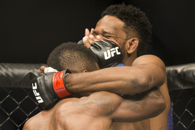 Lorenz Larkin, left, battles Neil Magny in the UFC 202 welterweight bout at T-Mobile Arena on Saturday, Aug. 20, 2016, in Las Vegas.  (Erik Verduzco/Las Vegas Review-Journal) Follow @Erik_Verduzco