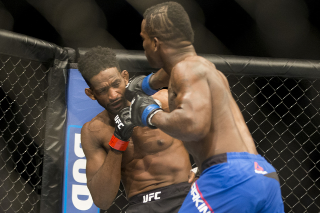 Lorenz Larkin, right, connects a right punch against Neil Magny in the UFC 202 welterweight bout at T-Mobile Arena on Saturday, Aug. 20, 2016, in Las Vegas. Erik Verduzco/Las Vegas Review-Journal  ...