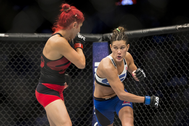 Randa Markos, left, battles Cortney Casey in the women's strawweight bout during UFC 202 at T-Mobile Arena on Saturday, Aug. 20, 2016, in Las Vegas. Casey won by a first round submission.  (Erik V ...