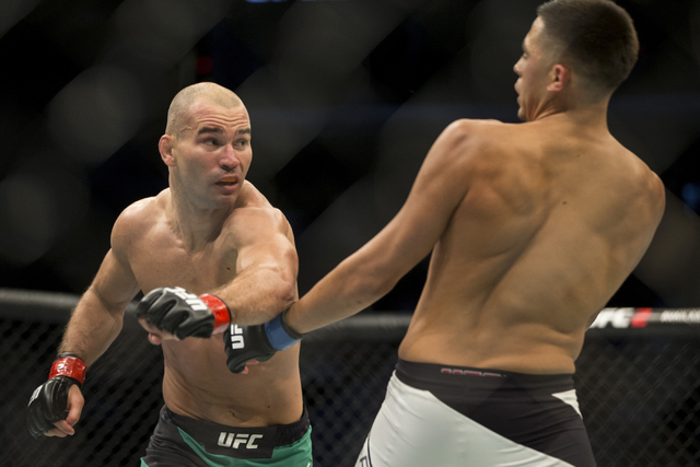 Artem Lobov, left, throws a  punch against Chris Avila in the UFC 202 featherweight bout at T-Mobile Arena on Saturday, Aug. 20, 2016, in Las Vegas. Lobov won by unanimous decision.  (Erik Verduzc ...