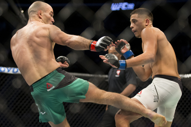Artem Lobov, left, connects a right kick against Chris Avila in the UFC 202 featherweight bout at T-Mobile Arena on Saturday, Aug. 20, 2016, in Las Vegas. Lobov won by unanimous decision.  (Erik V ...