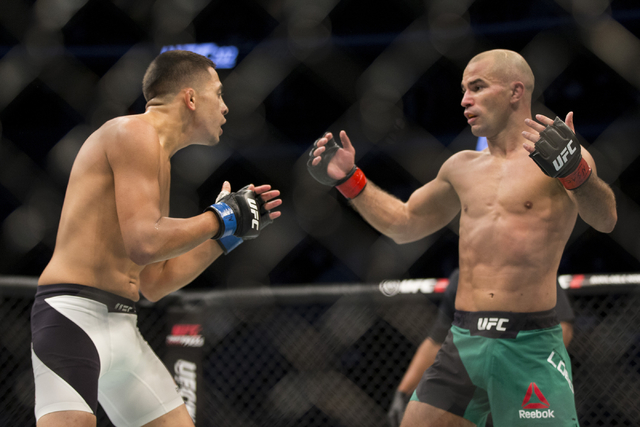 Chris Avila, left, battles Artem Lobov in the UFC 202 featherweight bout at T-Mobile Arena on Saturday, Aug. 20, 2016, in Las Vegas. Lobov won by unanimous decision.  (Erik Verduzco/Las Vegas Revi ...