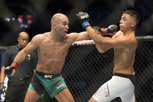 Artem Lobov, left, reaches for a punch against Chris Avila in the UFC 202 featherweight bout at T-Mobile Arena on Saturday, Aug. 20, 2016, in Las Vegas. Lobov won by unanimous decision.  (Erik Ver ...