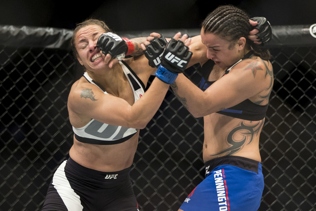 Elizabeth Phillips, left, battles Raquel Pennington in the women's bantamweight bout during UFC 202 at T-Mobile Arena on Saturday, Aug. 20, 2016, in Las Vegas. Pennington won by unanimous decisi ...