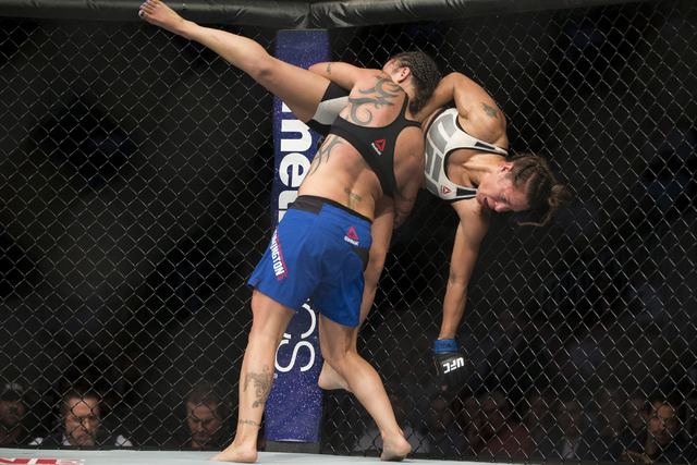 Elizabeth Phillips is taken down by Raquel Pennington in the women's bantamweight bout during UFC 202 at T-Mobile Arena on Saturday, Aug. 20, 2016, in Las Vegas. Pennington won by unanimous deci ...