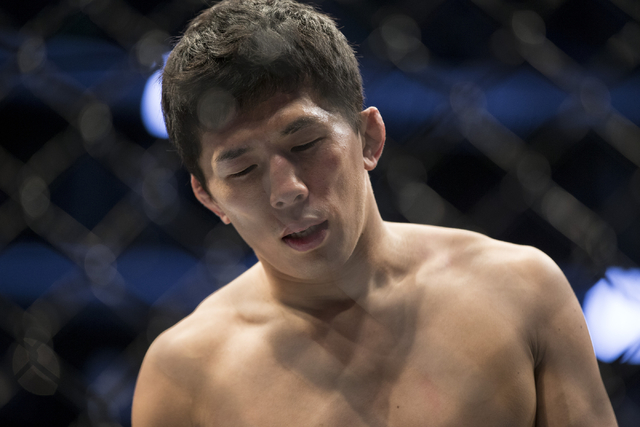Takeya Mizugaki lowers his head after losing against Cody Garbrandt by a first round technical knockout in the bantamweight bout during UFC 202 at T-Mobile Arena on Saturday, Aug. 20, 2016, in Las ...