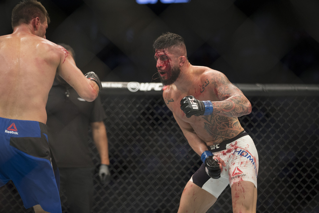 Sabah Homasi, right, battles Tim Means in the welterweight bout during UFC 202 at T-Mobile Arena on Saturday, Aug. 20, 2016, in Las Vegas. Means won by technical knockout in the second round.(Erik ...