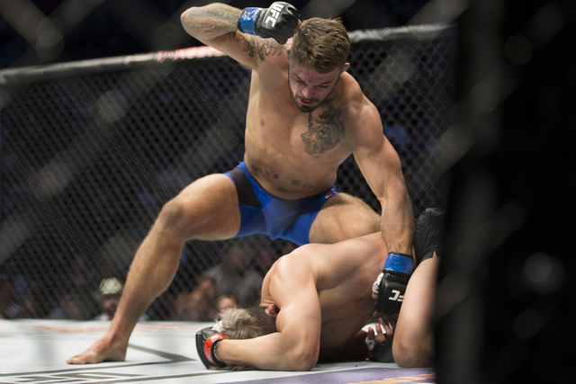 Mike Perry, top, throws a punch against Hyun Gyu Lim in the welterweight bout during UFC 202 at T-Mobile Arena on Saturday, Aug. 20, 2016, in Las Vegas. Perry won by a first round technical knocko ...