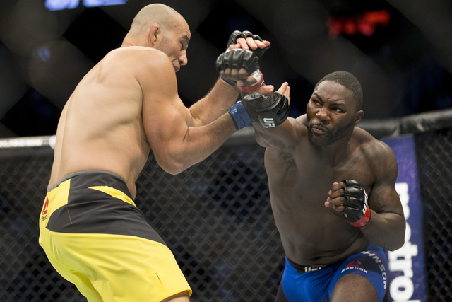 Anthony Johnson, right, throws a right punch against Glover Teixeira in the light heavyweight bout during UFC 202 at T-Mobile Arena on Saturday, Aug. 20, 2016, in Las Vegas. Johnson won by a first ...