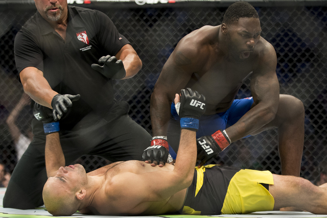 Anthony Johnson, top, finishes Glover Teixeira to win by a first round knockout in the light heavyweight bout during UFC 202 at T-Mobile Arena on Saturday, Aug. 20, 2016, in Las Vegas. (Erik Verdu ...